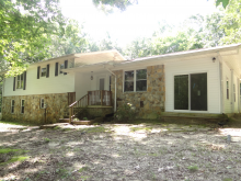 This secluded tri-level home offers tons of privacy!